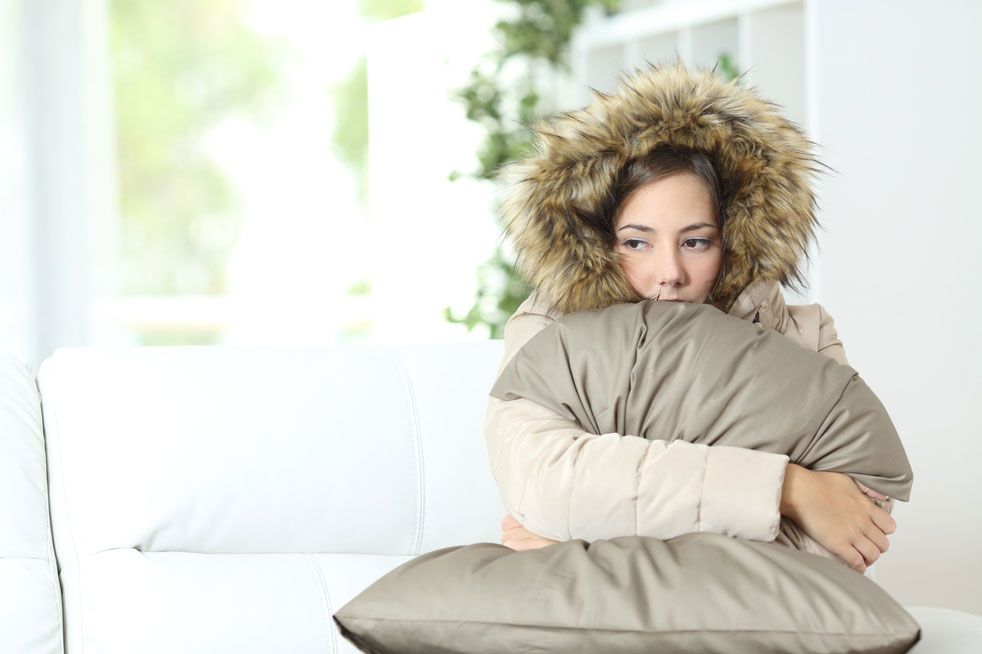 woman in room feeling cold